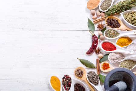 Photo for various herbs and spices for cooking on wooden table, top view - Royalty Free Image