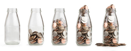 Saving coin money in glass bottle isolated.