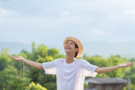 Photo for Happy asian man with big backpack of camera gear enjoy in green nature of public park or tropical forest. - Royalty Free Image