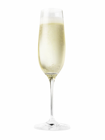 Shot of a champagne glass full of champagne cut out on a white background