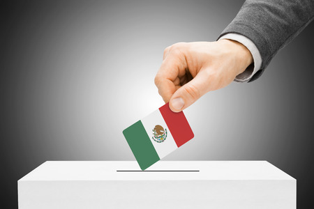 Voting concept - Male inserting flag into ballot box - Mexico