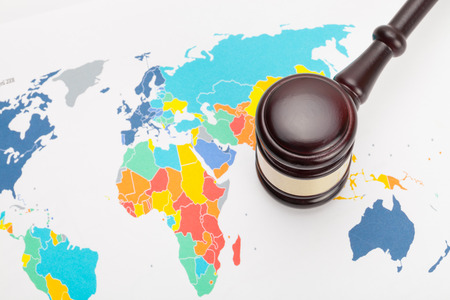 Judge's gavel and over world map