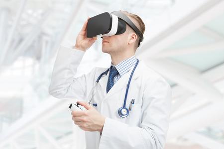 Photo pour Indoors close up shot of doctor wearing virtual reality glasses - image libre de droit