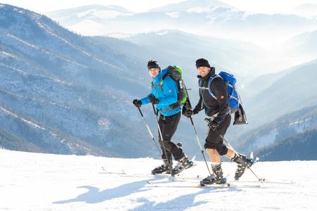 CHOPOK, SLOVAKIA - JANUARY 24, 2017: Two Skiers going up to the very top of Chopok mountain at Jasna ski resort, January 24, 2016 in Jasna - Slovakia