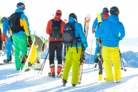 CHOPOK, SLOVAKIA - JANUARY 24, 2017: Skiers and snowboarders preparing for downhill ride from the top of Chopok mountain at Jasna ski resort, January 24, 2016 in Jasna - Slovakia