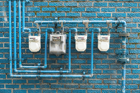Photo pour Several gas meters located on a blue wall of a residential building - image libre de droit