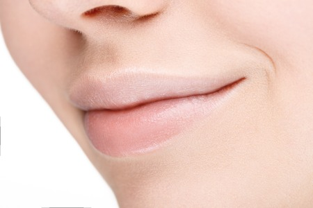Part of face with beautiful full lips without makeup. Close-up.