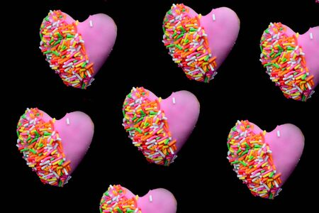 Photo pour Heart shape of donut covered by pink chocolate rainbow sprinkle decoration on isolate,Valentine day - image libre de droit