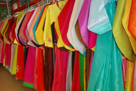 Photo pour Lots of Colorful Hanbok hang on the wall, traditional dress of South Korea - image libre de droit