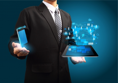 Modern wireless technology and social media concept, Mobile phone with tablet computer in the hand
