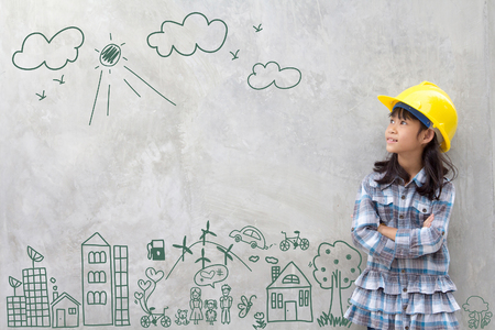 Photo pour Little girl engineering with creative drawing environment with happy family, eco friendly, save energy, against a brick wall - image libre de droit