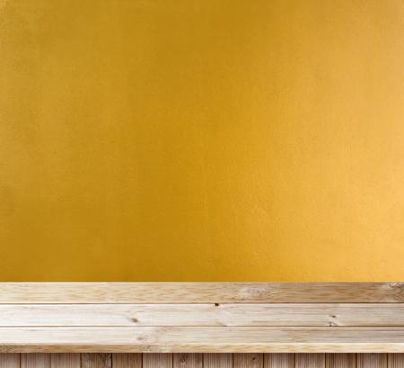 Photo pour Table top wooden deck on yellow wall texture - image libre de droit