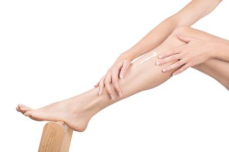 Photo pour Female hands massage female leg with cream, close up - image libre de droit