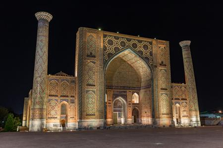 Ulugh Beg Madrasah at night in Samarkand, Uzbekistan