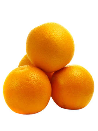 Pile of four oranges isolated on white background