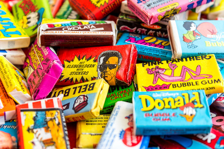 ASHDOD, ISRAEL - SEPTEMBER 27, 2015: Many various colorful chewing or bubble gum from seventies, eighties and nineties, including Robocop, Turbo, Donald Duck, BomBibom, TipiTip, X-Men, Dunkin, OtoMoto