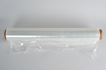 Photo pour coiled roll of transparent polyethylene for food packaging on a white background - image libre de droit