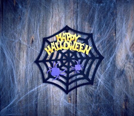 Foto de white spider web in the corner of the composition, gray wooden background from old boards, backdrop  for Halloween holiday - Imagen libre de derechos