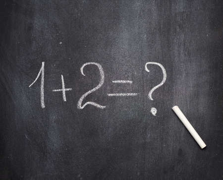 Photo pour math example written in white chalk on a black chalk board and white chalk, one plus two - image libre de droit