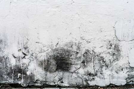 Foto de texture of an old wall with uneven cracked stucco, dirty surface of the exterior painted wall, architecture abstract background - Imagen libre de derechos