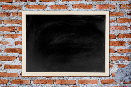 blackboard with wooden bamboo frame, blackboard on old brick wall  background for concept education