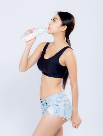 Photo for Beautiful portrait asian young woman bottle of water for healthy isolated on white background, girl with fit thirsty after exercise and fitness, health concept. - Royalty Free Image