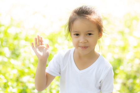 Photo for Portrait face of cute asian little girl and child happiness and fun in the park in the summer, smile and happy from asia kid and relax in the garden, lifestyle childhood concept. - Royalty Free Image