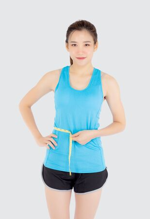 Photo pour Beautiful slim young asian woman measuring tape thin waist wear uniform fitness isolated white background, asia girl loss weight for diet with exercise and workout wellbeing and healthy care body. - image libre de droit