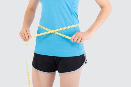 Photo for Beautiful slim closeup asian woman measuring tape thin waist wear uniform fitness isolated white background, asia girl loss weight for diet with exercise and workout wellbeing and healthy care body. - Royalty Free Image