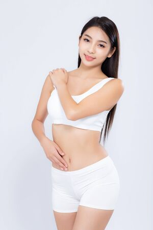 Photo pour Portrait young asian woman smiling beautiful body diet with fit isolated on white - image libre de droit