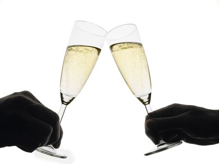 silhoutte of two hands toasting with champagne