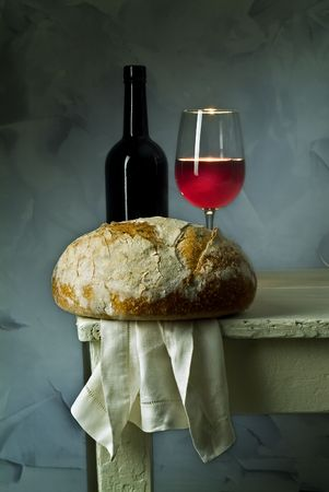 red wine glass, bottle and loaf of sour dough bread