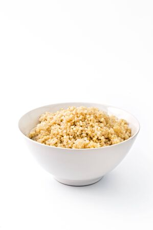 bowl of cooked quinoa with onion isolated on white