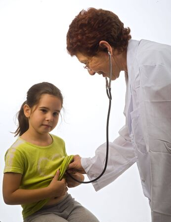 senior women doctor examening a young girl paitent