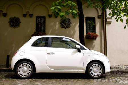 Photo for cute white small car, urban view - Royalty Free Image