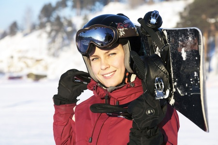The young adult female snowboarderの写真素材