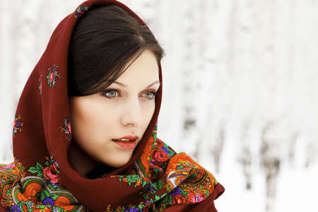 Gorgeous woman in shawl on her headの写真素材