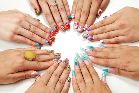 Female hands with various nail artsの写真素材