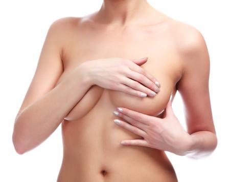 Photo pour Woman controlling brest for cancer, isolated on white - image libre de droit