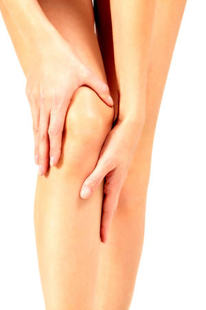 Photo pour Pain in a knee, woman touches her knee, isolated on white background - image libre de droit
