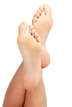 Foto de Female bare feet on white background - Imagen libre de derechos