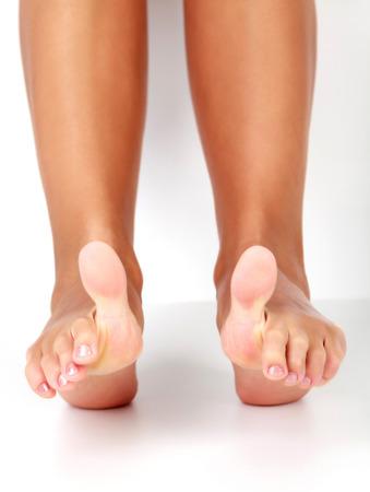 Photo pour Closeup shot of female feet with big toes up. - image libre de droit