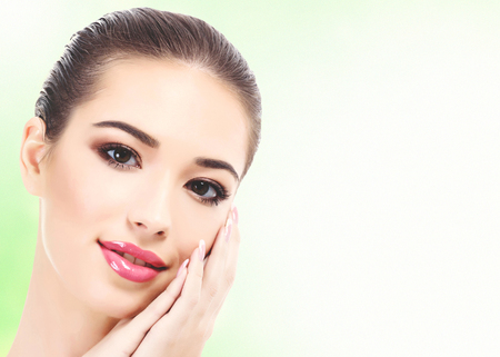 Photo pour Closeup shot of beautiful woman with clean fresh skin, abstract green blurred background with copyspace - image libre de droit