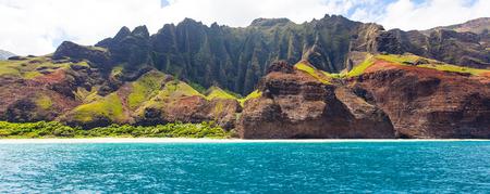 panorama of dramatic cliffs at na pali coast at kauai, hawaii, view from water