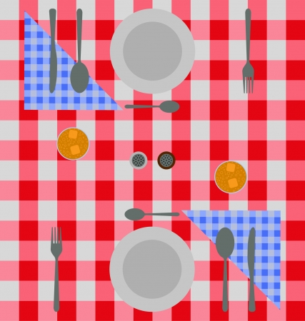 Abstract dinner setting of plates silverware and napkins in blue and red checks