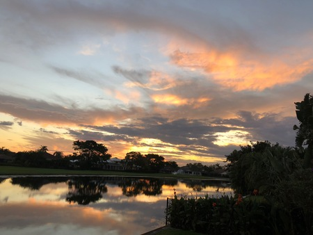 reflection of tropical sunset in the lake of yard