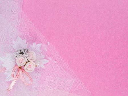 Weddings accessorie a buttonhole  on a pink background