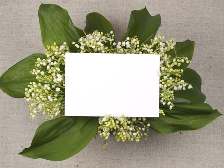 Photo pour Card for congratulation  and lily of the valley on a background from a canvas - image libre de droit