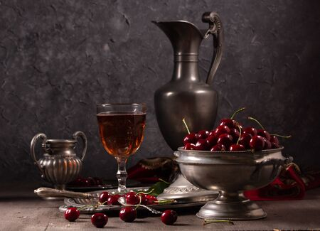 Photo pour Vintage still life with cherry and pewter - image libre de droit