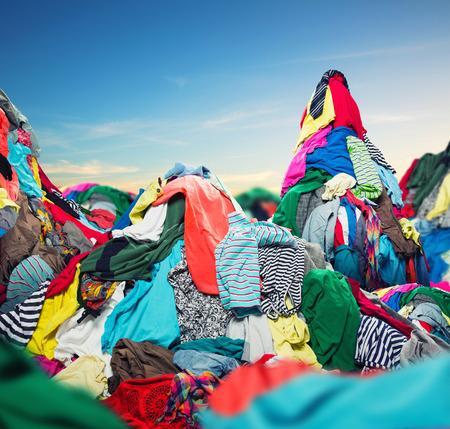 Photo pour Big heap of colorful clothes on sky background - image libre de droit
